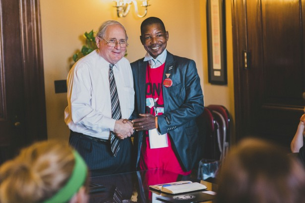 Alexis Mbolinani (right) with Senator Carl Levin